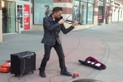 Filipino Street Musician performing in USA streets - Performing